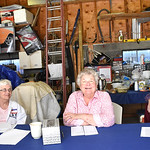 ANNE NEBORAK-DIGITAL FIRST MEDIA Carol Quinn greets voters at her garage which twice a year is a polling place. She sits in the center. To the left of her is Ellen Morrisroe , the Majority l ...